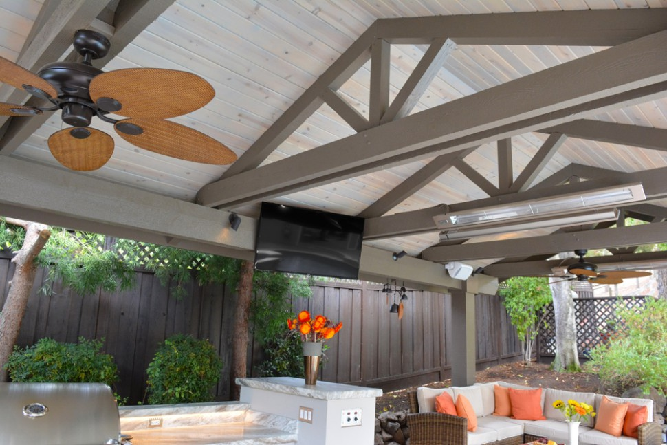 Infrared heaters, ceiling fans, and shades offer climate control in Alamo, CA outdoor kitchen and living space remodel
