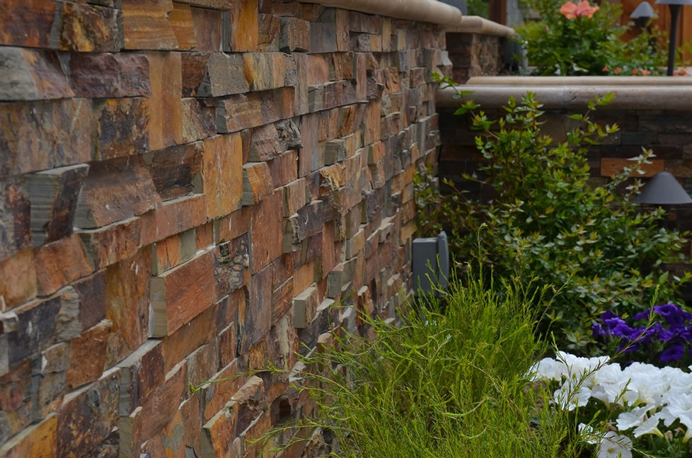 Custom stone retaining walls in backyard redesign in Alamo, CA.