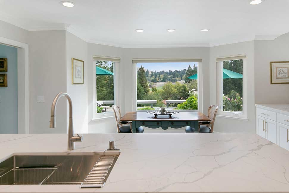 The countertops are done in a marble-inspired Calcutta Laza Quartz slab