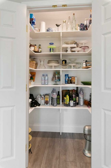 the pantry was re-centered on the main wall to make it more visually appealing for the space