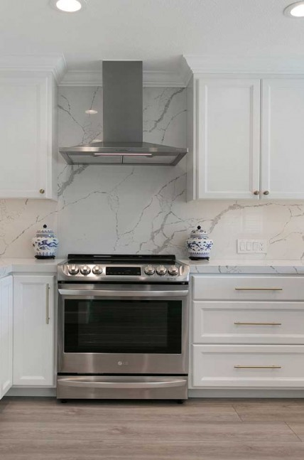 The full height backsplash is a stunning marble-inspired Calcutta Laza Quartz slab