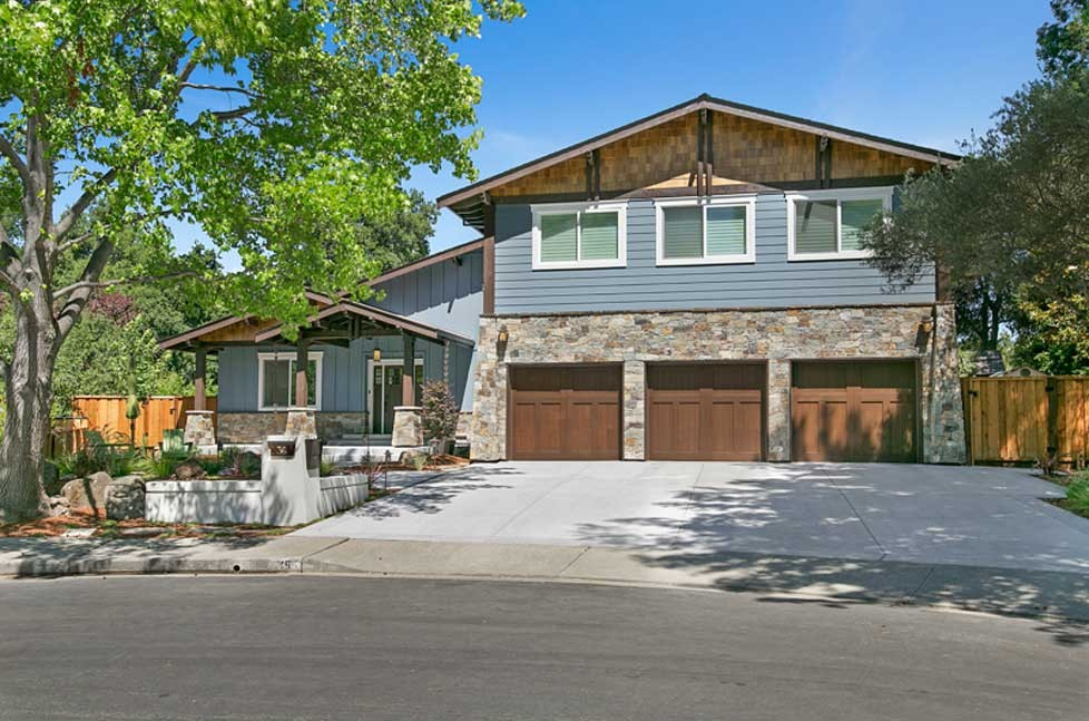 All new craftsman-style wood garage doors