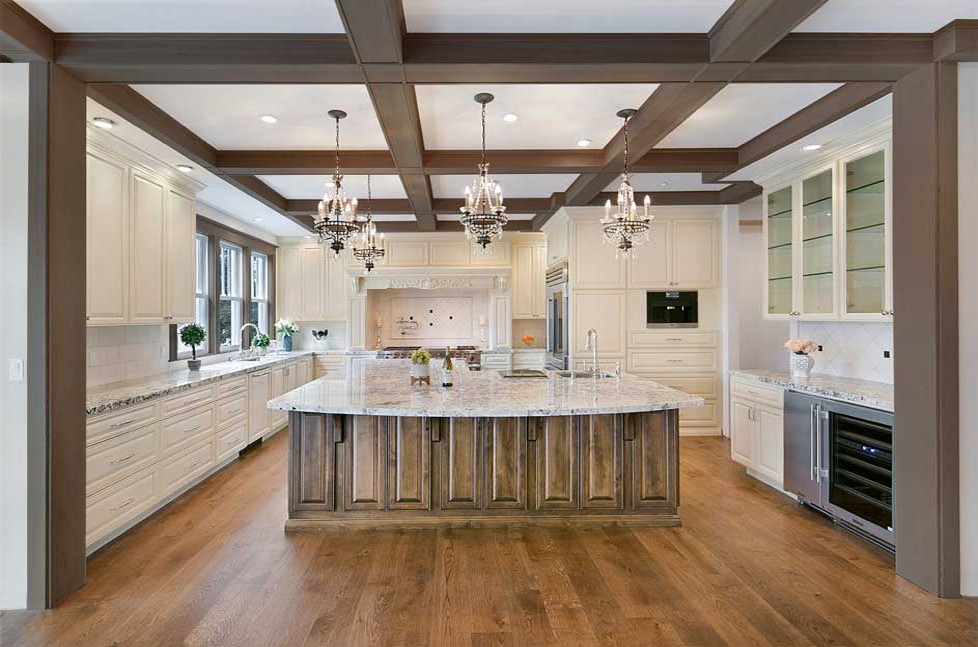 Custom wood beam work in this renovated kitchen makes for a stunning focal point.