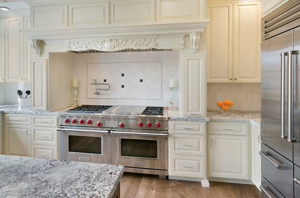 This beautiful custom hood includes unique corbels and other intricate details.