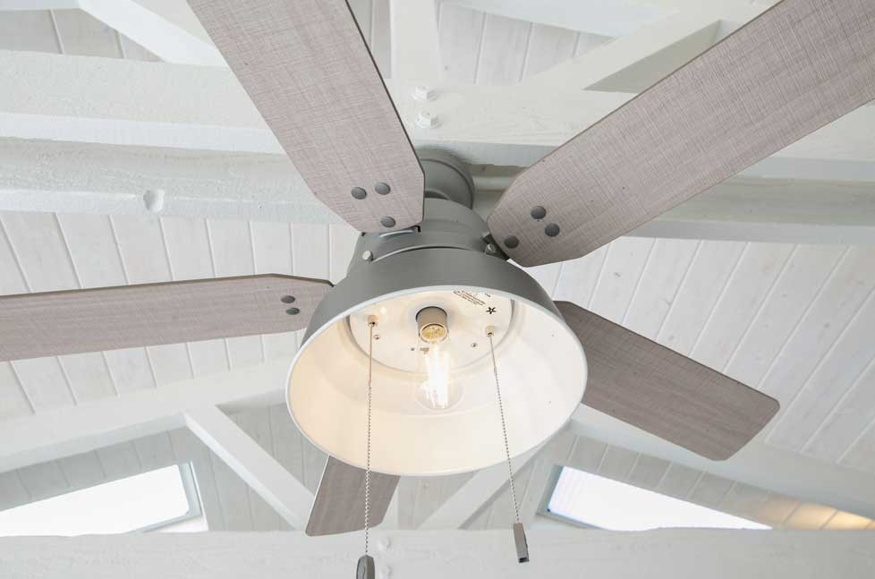 A modern ceiling fan keeps the outdoor space cool on hot days.