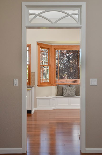 Adding a painted transom above the cased opening in the entryway, made the space feel larger.